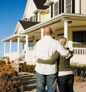 Couple Admiring A Safe Smart Home